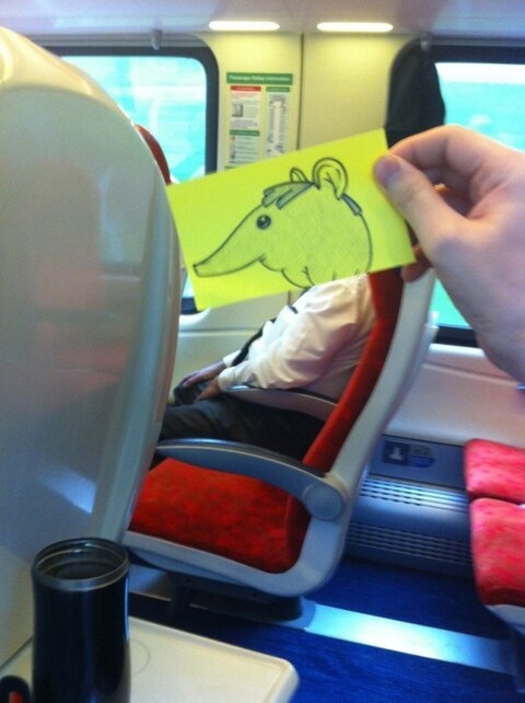 Man Turns Train Commuters Into Cartoon Faces To Pass Time On His Commute To Work