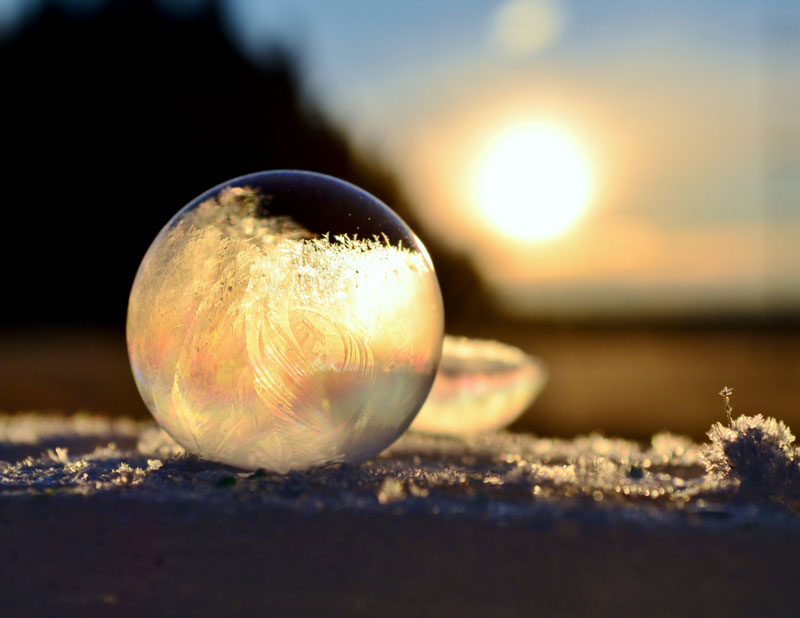 A Mom And Her Son Blow Bubbles In Freezing Cold And Create A Spherical Beauty