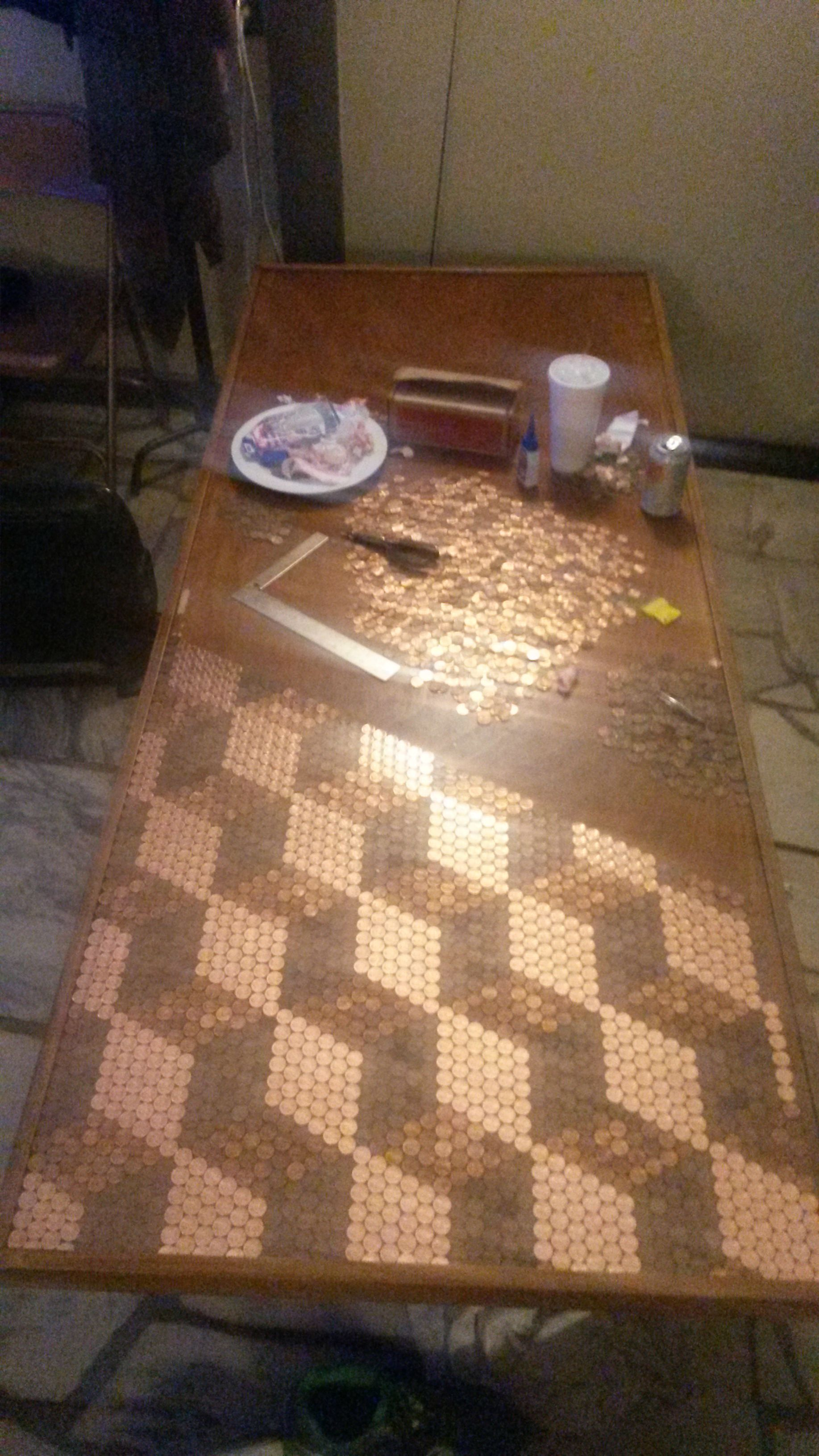 Guy Builds Impressive Table Out Of Old Door And 5000 Pennies