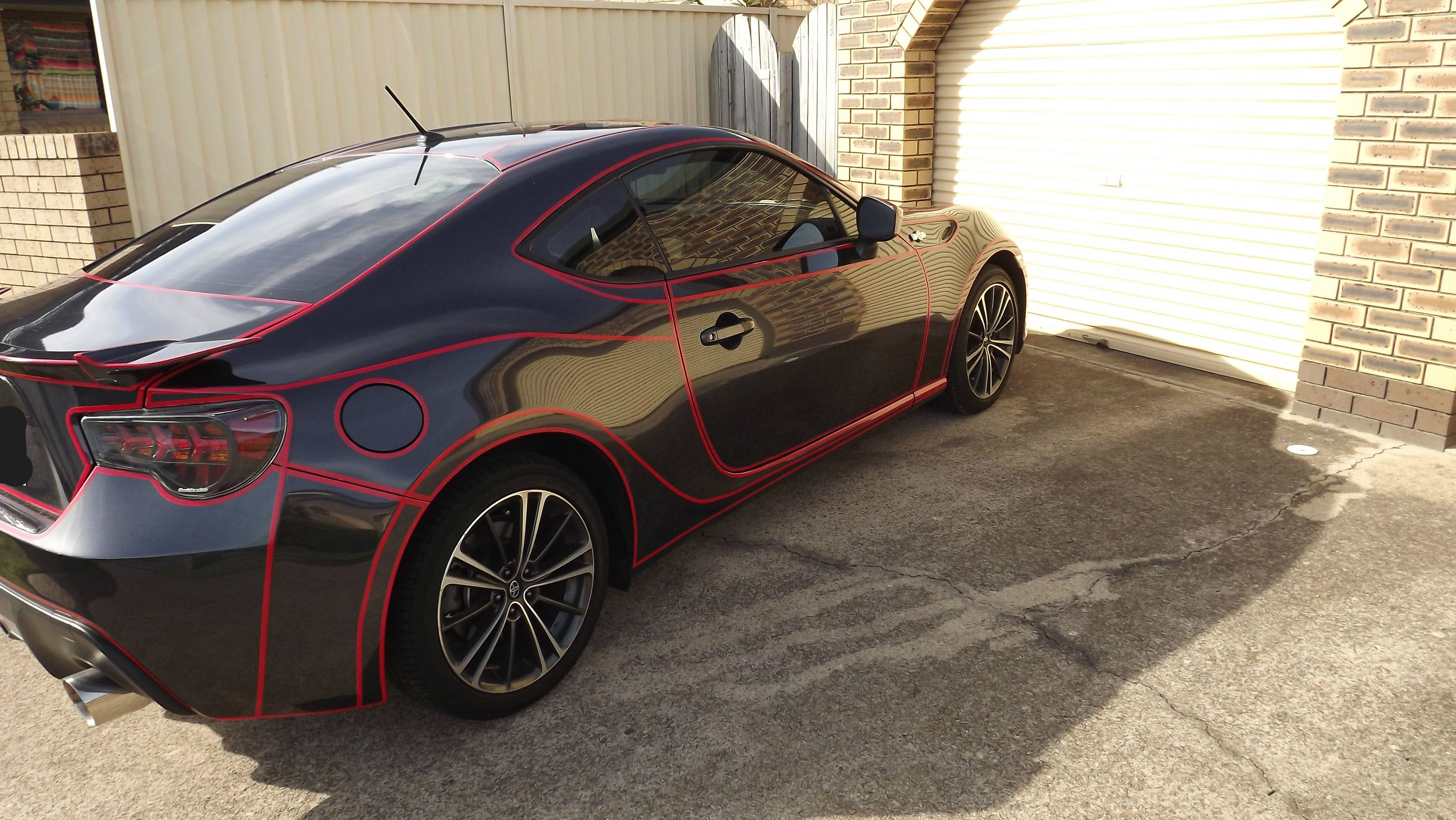 Guy Makes Tron Car Using Reflective Vinyl Tape And It's Awesome