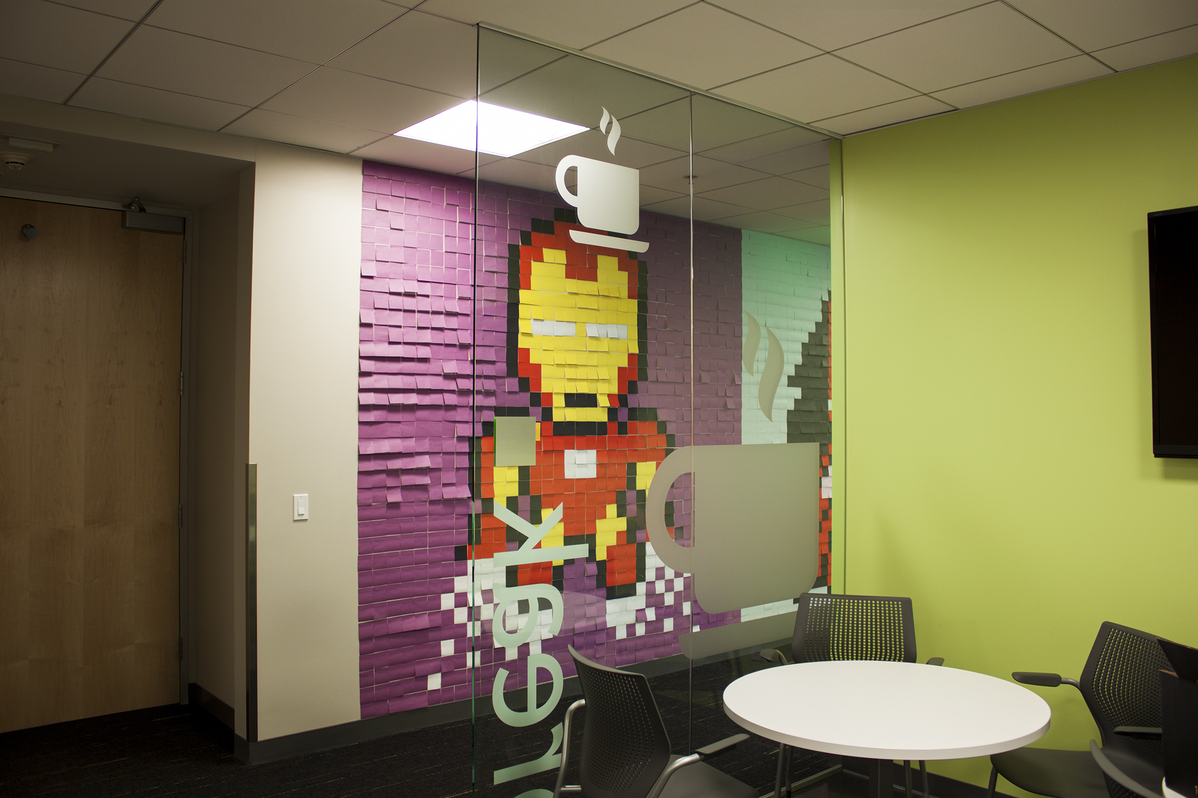 Bored Employee Uses 8,024 Post-It Notes To Turn Boring Office Walls Into Superhero Murals