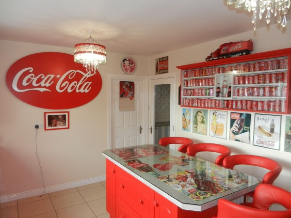 House Looks Normal From Outside, Completely Covered In Coca Cola Memorabilia On The Inside