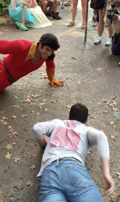 Man Gets Hilariously Defeated After Challenging Gaston To A Push Up Contest At Disney World