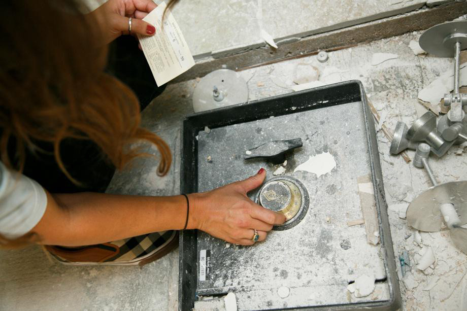 Couple Finds A Hidden Safe Containing Over $51,000 Hiding Behind The