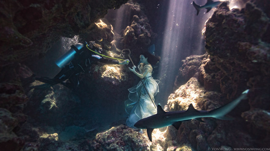 Model Tied Down Underwater With Sharks Swimming Around Her For A Surreal Photoshoot