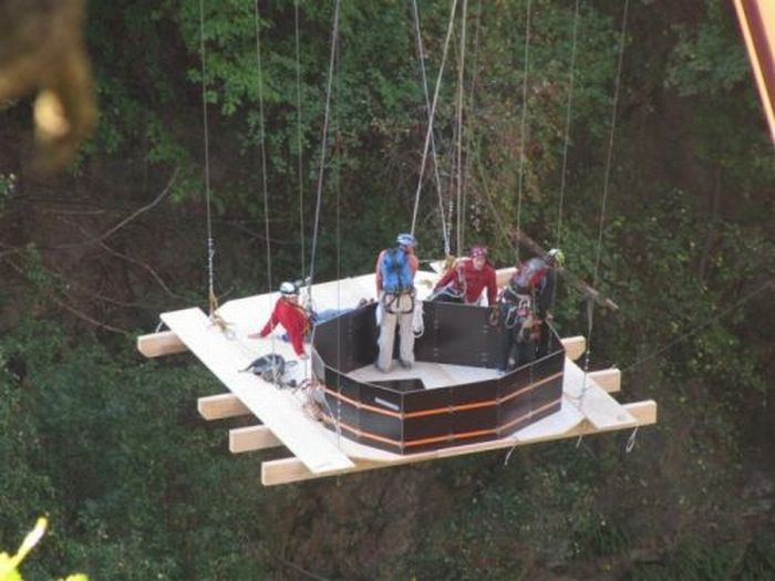 People Suspend A Handmade Hot Tub From A Bridge Because Why Not