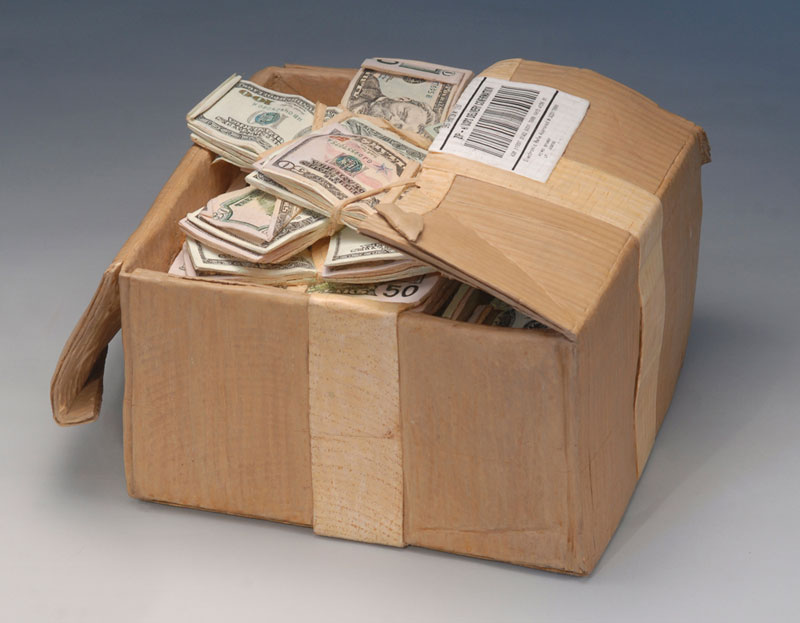 Man Carves A Block Of Wood Into A Box Of Cash