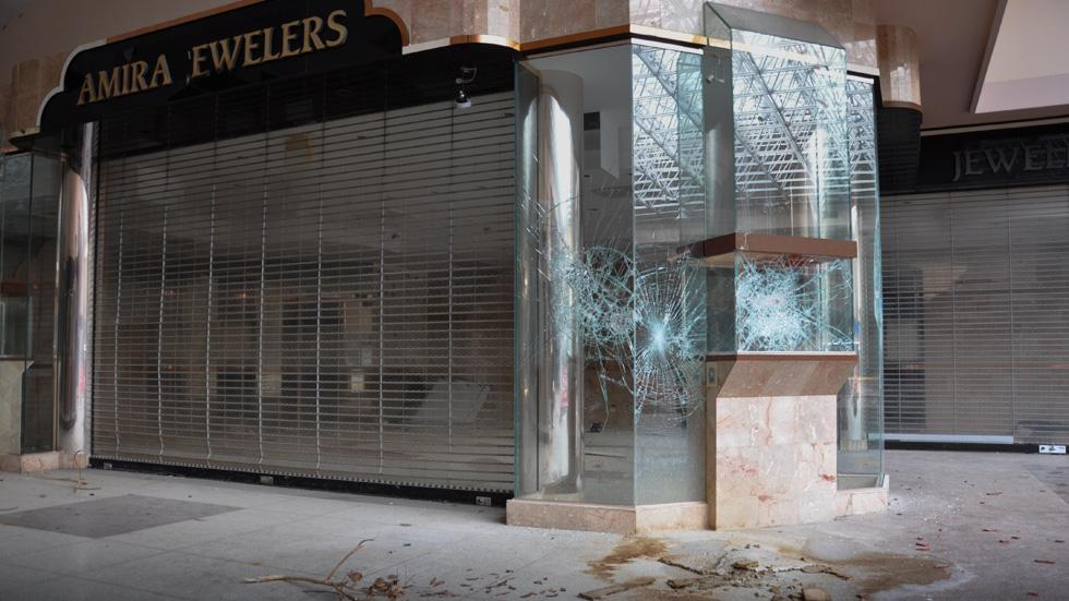 Photographer Explores An Eerie Abandoned Mall To Show The Sad Economic Decline