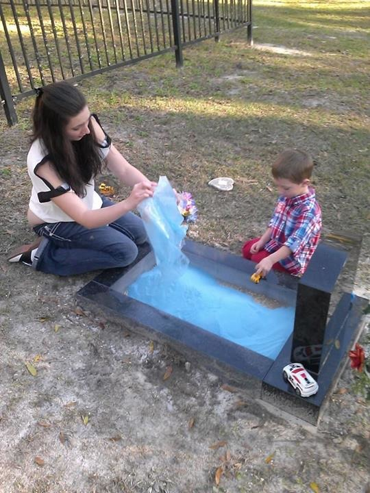 Mom Adds Sandbox To Baby's Gravestone So That Big Brother Can Play With Him
