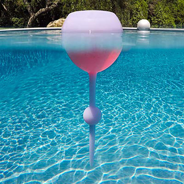 Never Worry About Spilling Your Wine With These Glasses That Float In Water And Stick Up In The Sand